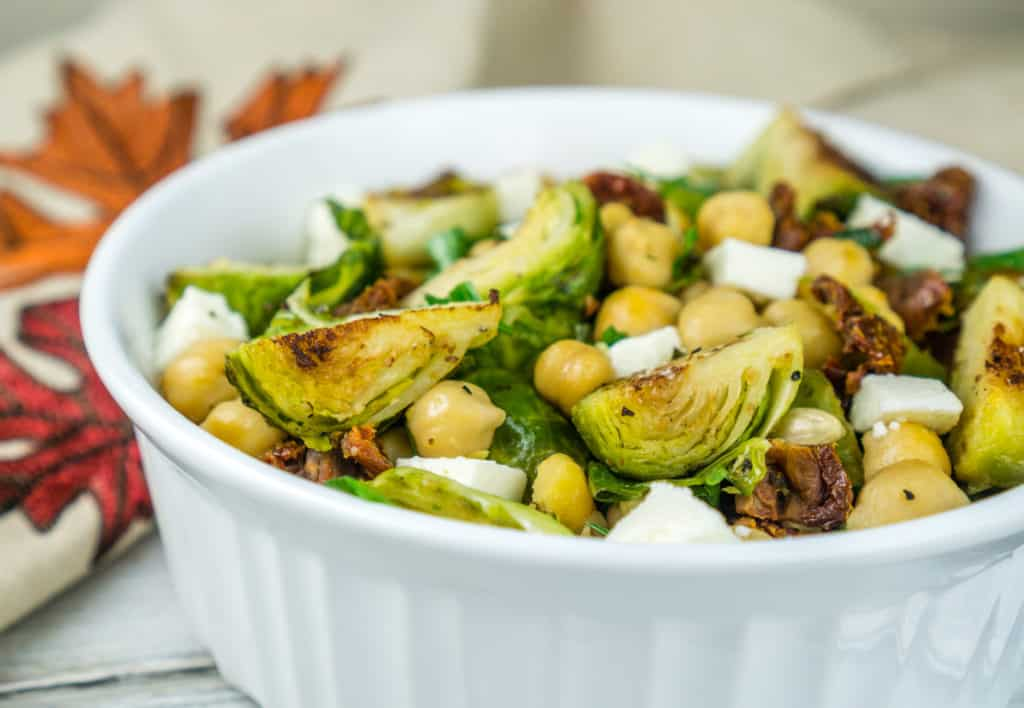 Roasted Brussels Sprouts and Chickpeas Salad with Sun-Dried Tomatoes and Queso Fresco in a lemony dressing. From www.www.babaganosh.org