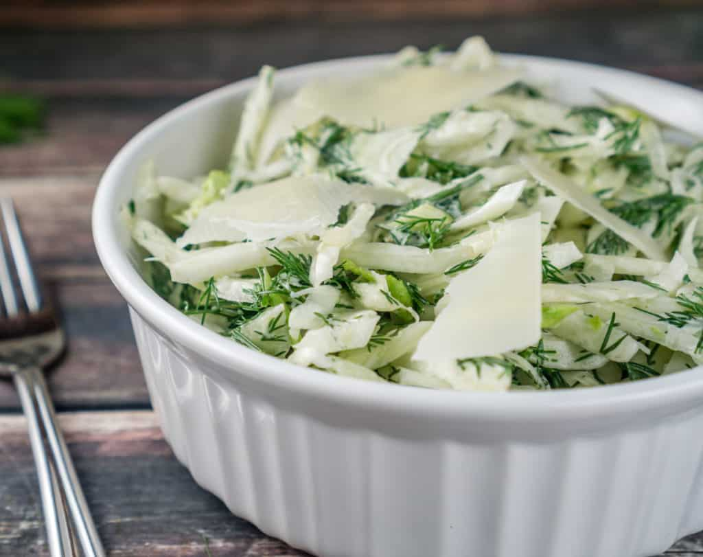 This crunchy Fennel Salad with Dill is absolutely addicting with delicious Parmesan cheese mixed into the dressing. It's super easy to make and will become a family favorite in no time! From www.www.babaganosh.org