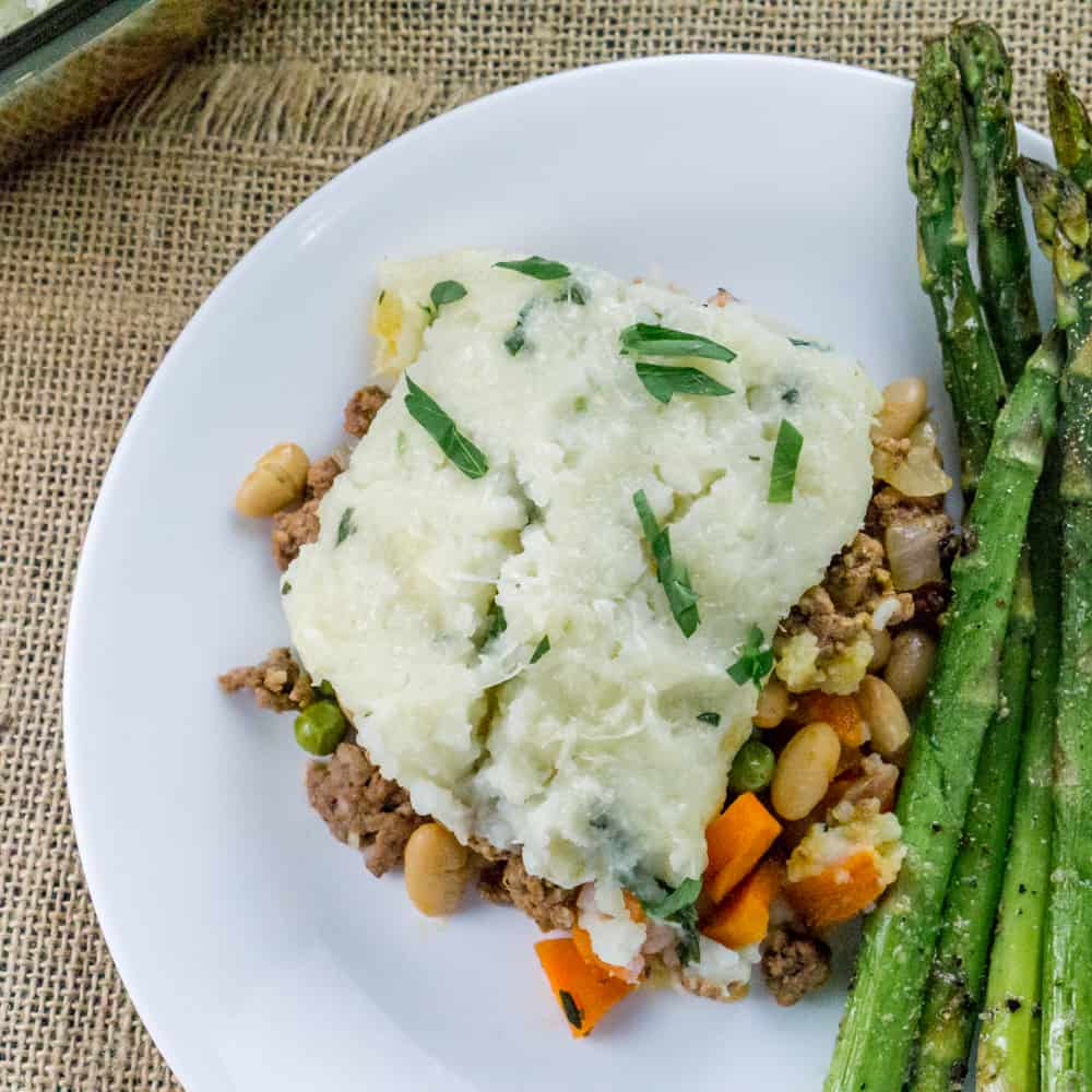 This Shepherd's Pie with White Beans is the ultimate comfort food recipe using leftover mashed potatoes and other hearty ingredients for a delicious, easy casserole.
