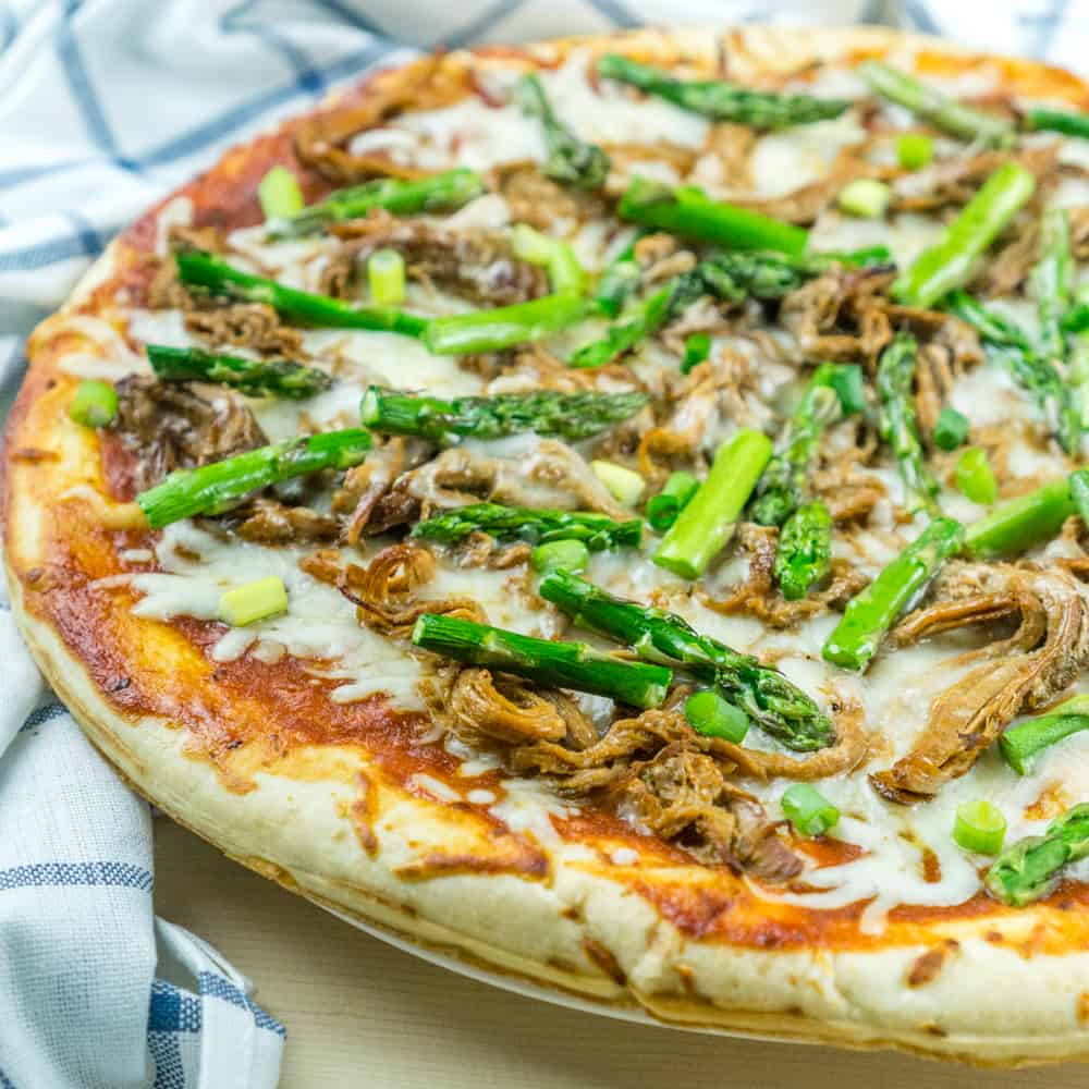 Use leftover pulled pork to make this BBQ Pulled Pork Pizza with Asparagus in just 20 minutes for a delicious dinner!