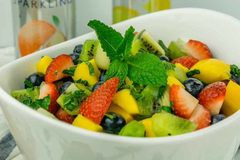 image of fruit salad with mint and honey lime dressing