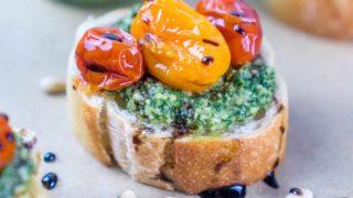 Pesto and Burst Tomato Crostini with Balsamic Glaze Drizzle