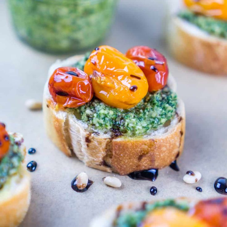 Pesto and Burst Tomato Crostini with Balsamic Glaze Drizzle