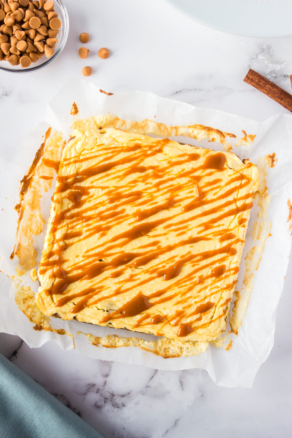 baked blondies with cream cheese topping and a butterscotch drizzle