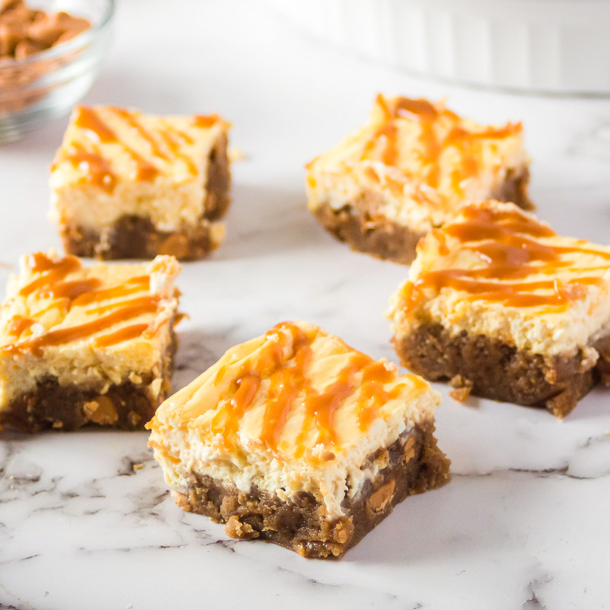 pieces of butterscotch blondies with cream cheese topping