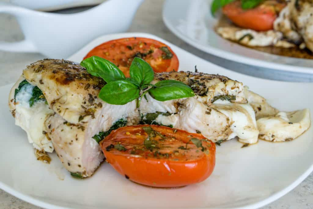 Spinach and Mozzarella Stuffed Chicken Breast with Roasted Tomatoes