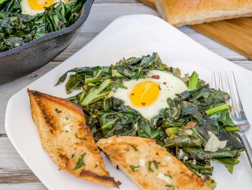 Green Shakshuka with Homemade Garlic Bread on a plate.