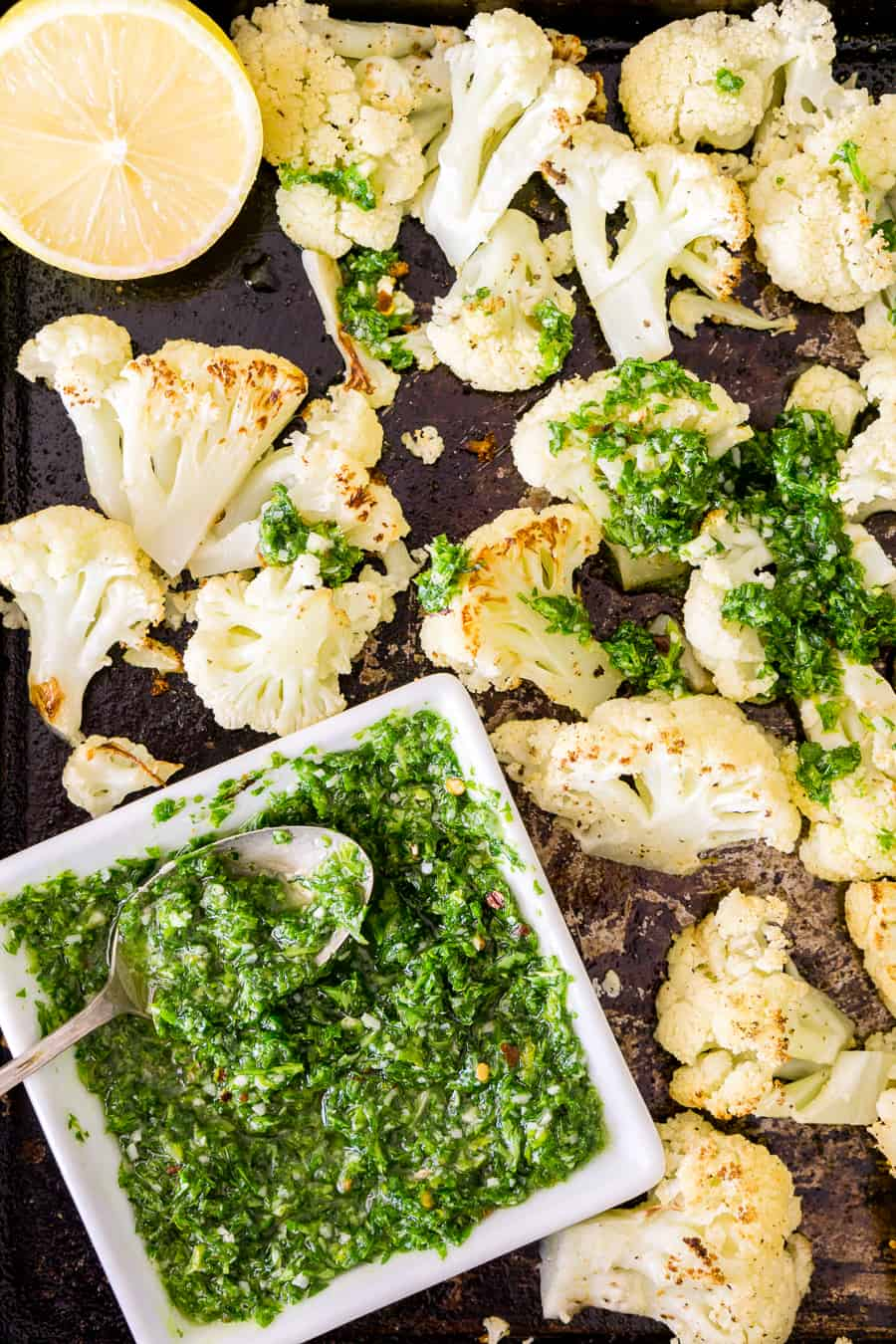 overhead shot of roasted cauliflower with parsley pesto