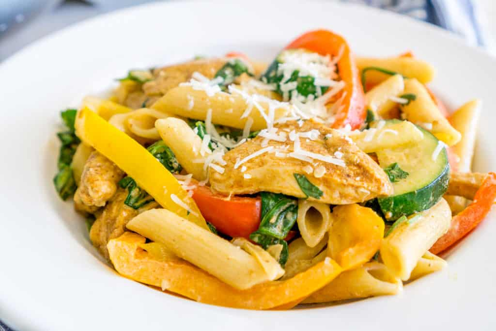 veggie-loaded creamy chicken fajita pasta in a plate