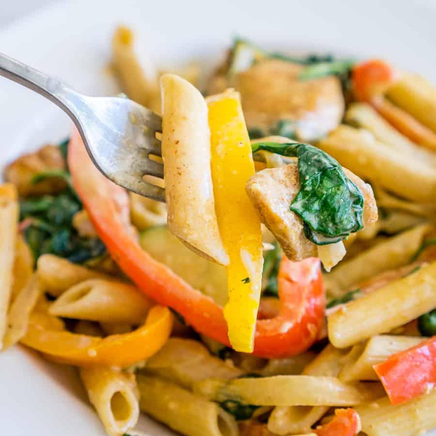 veggie-loaded creamy chicken fajita pasta on a fork