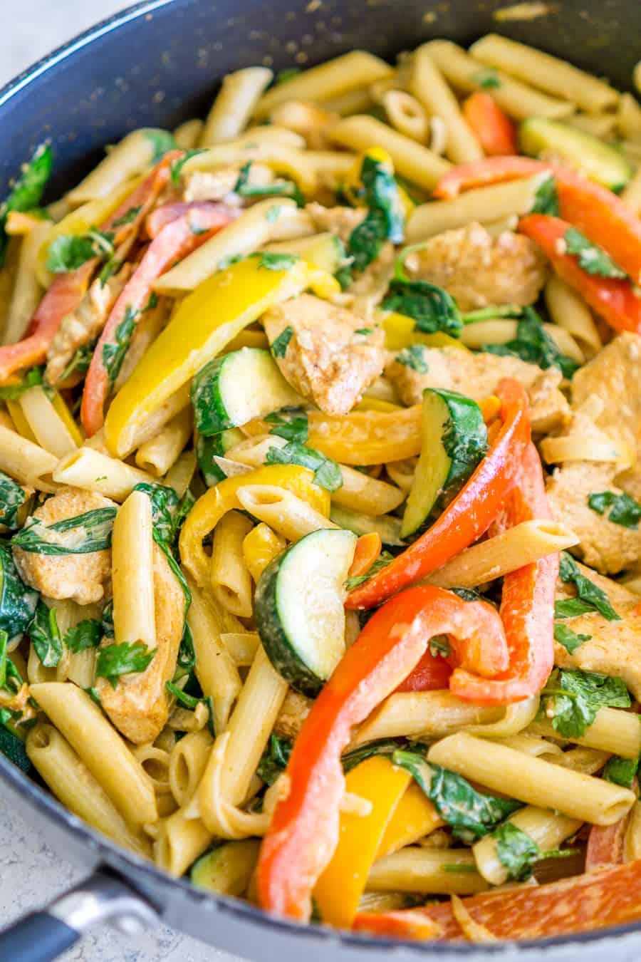 creamy chicken fajita pasta in a skillet