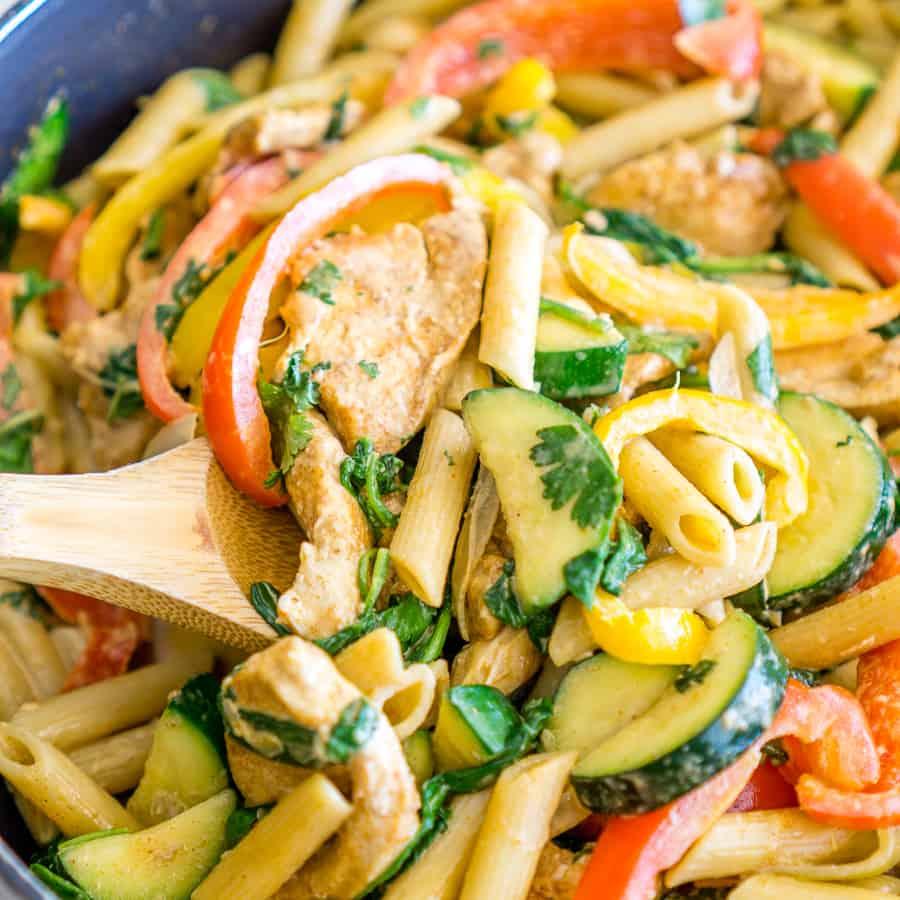 close up of creamy chicken fajita pasta in a skillet