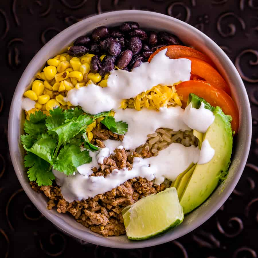 image of brown rice taco bowl with lime crema