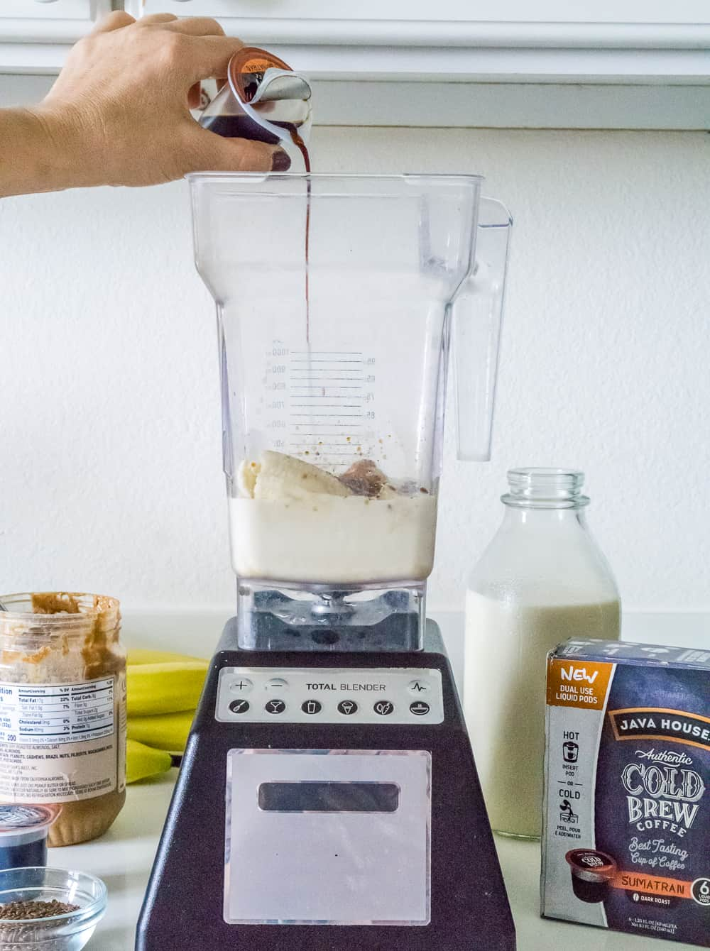 image of blender with breakfast smoothie ingredients