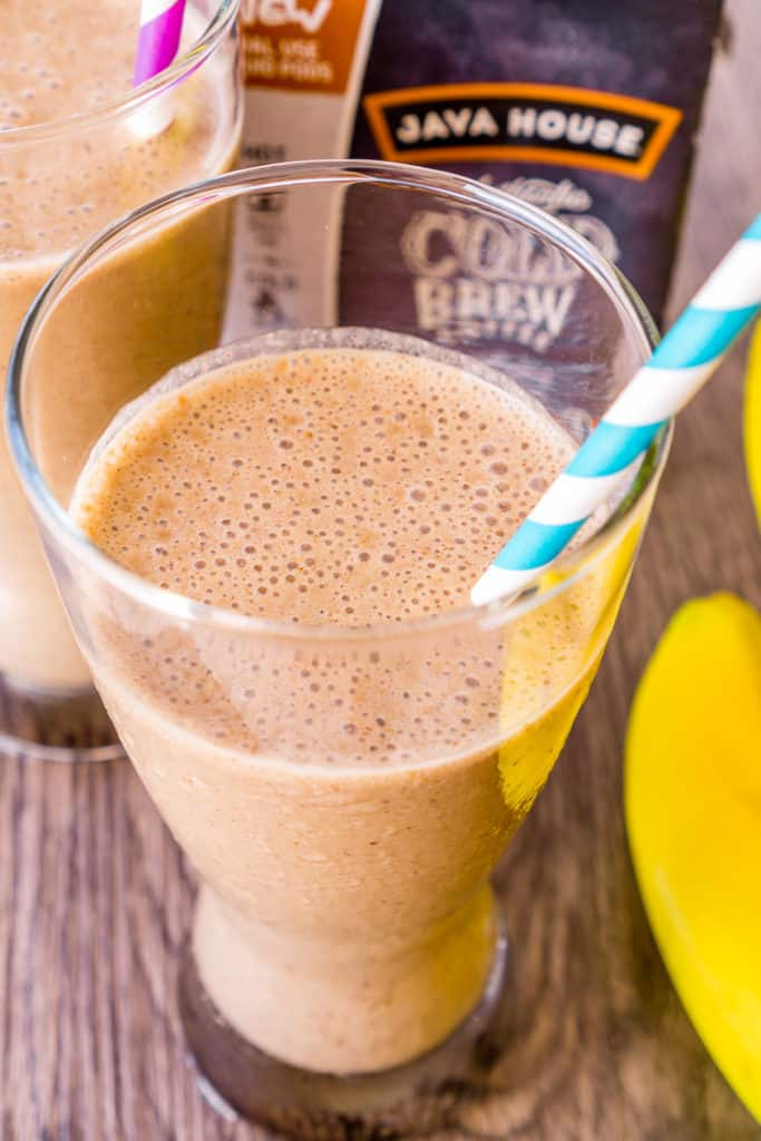 image of coffee breakfast smoothie in a glass with straw