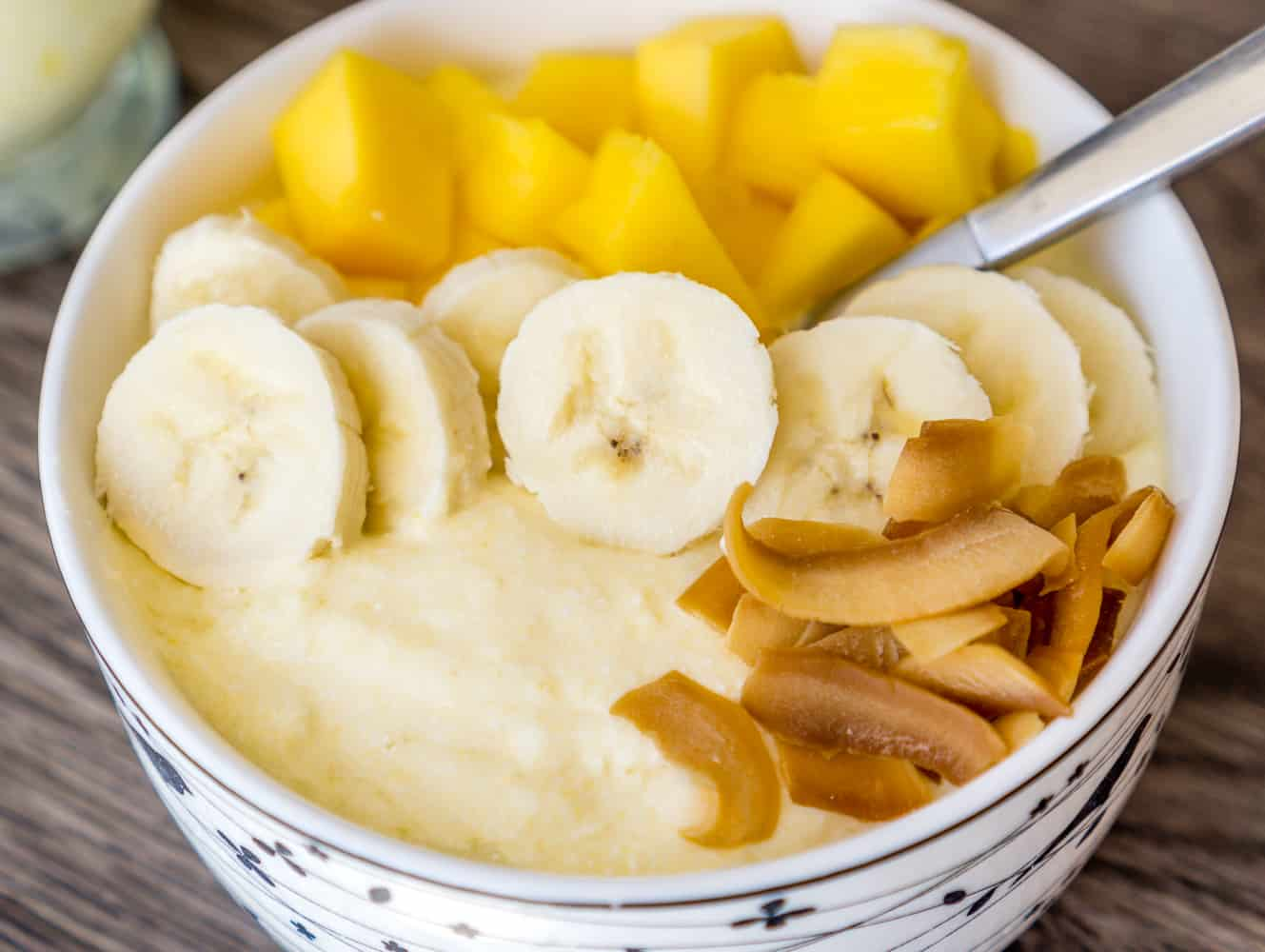 image of mango whipped cottage cheese with bananas and toasted coconut