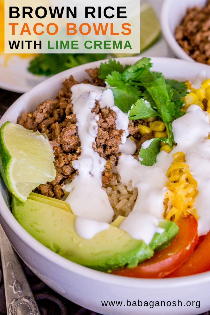 pinterest image of brown rice taco bowls with lime crema