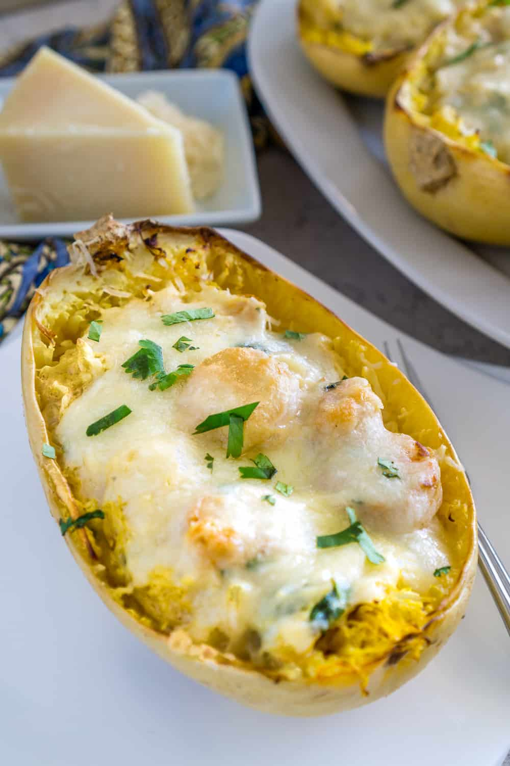 image of roasted spaghetti squash boats with shrimp Alfredo