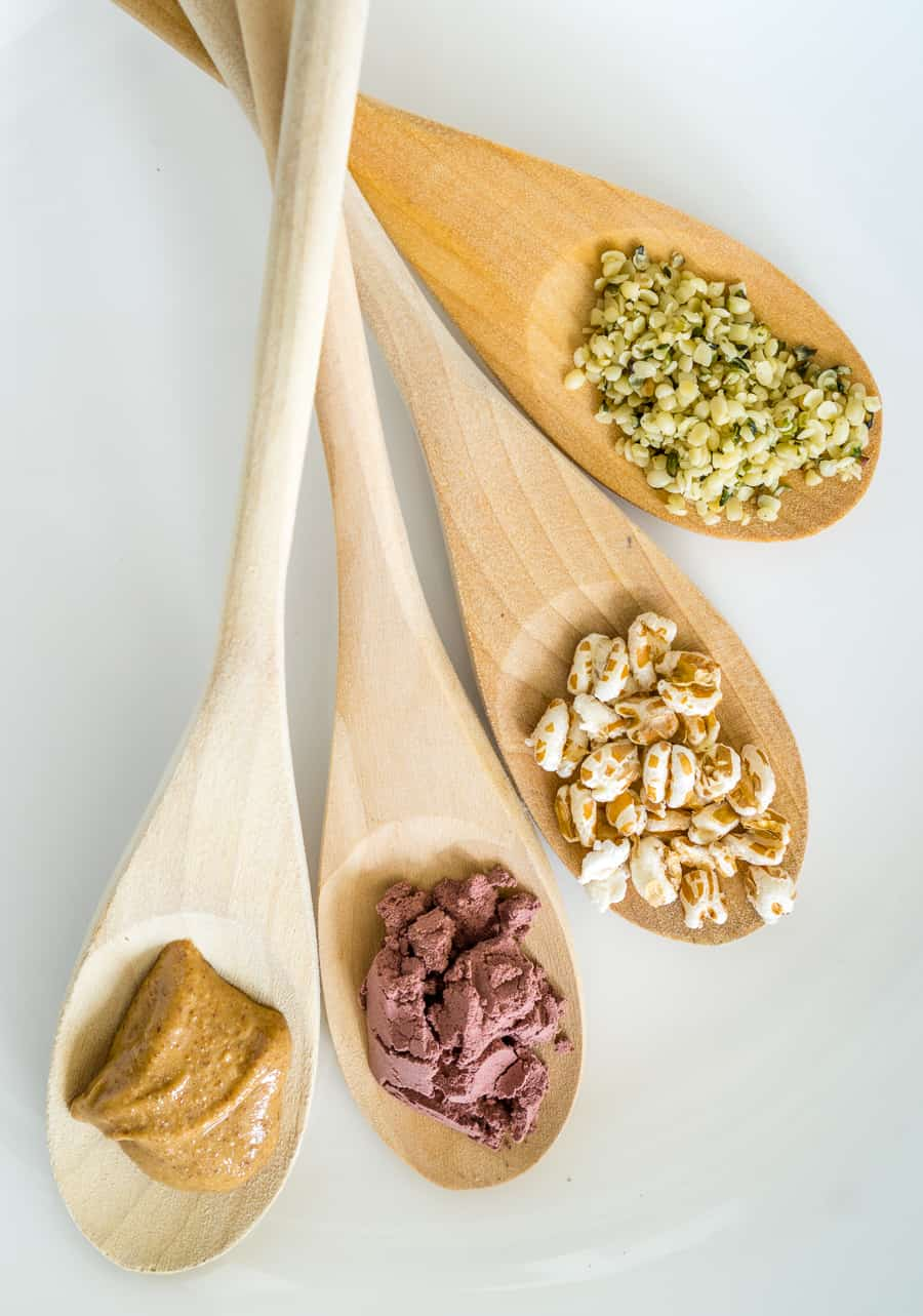 image of toppings for whipped cottage cheese bowl: hemp seeds, puffed wheat, acai powder, and almond butter