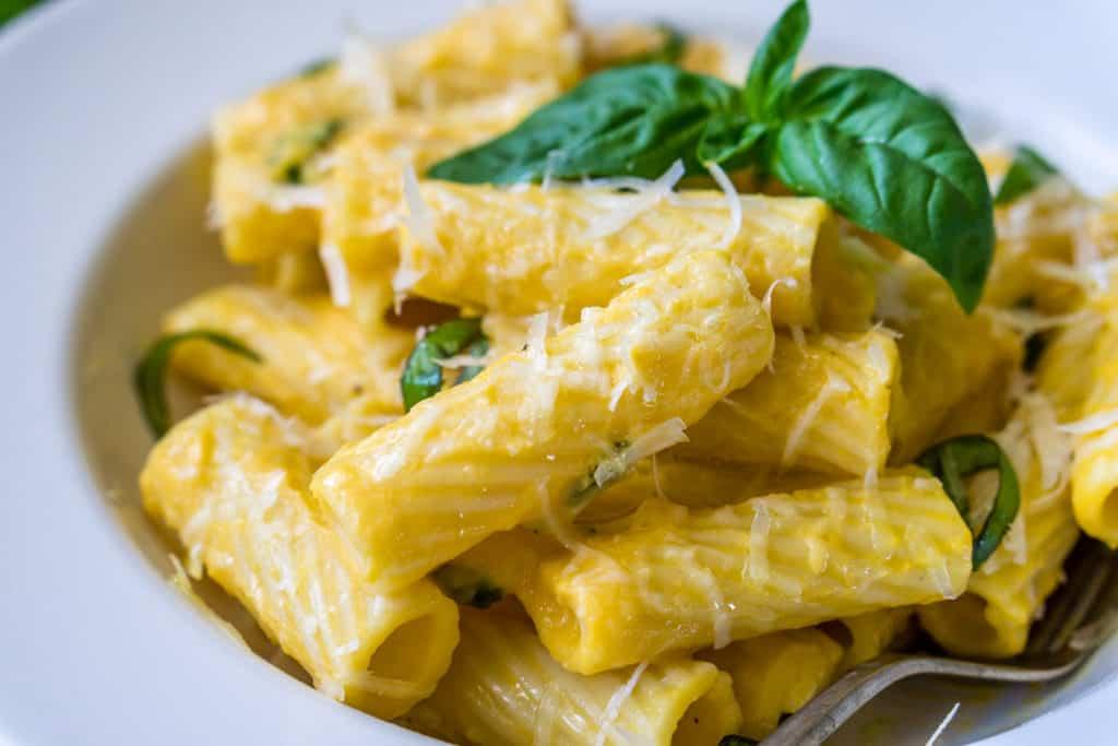 image of butternut squash alfredo pasta garnished with fresh basil