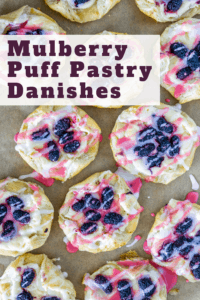overhead image of mulberry puff pastry danishes drizzled with mulberry icing