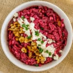 image of russian beet salad topped with feta cheese