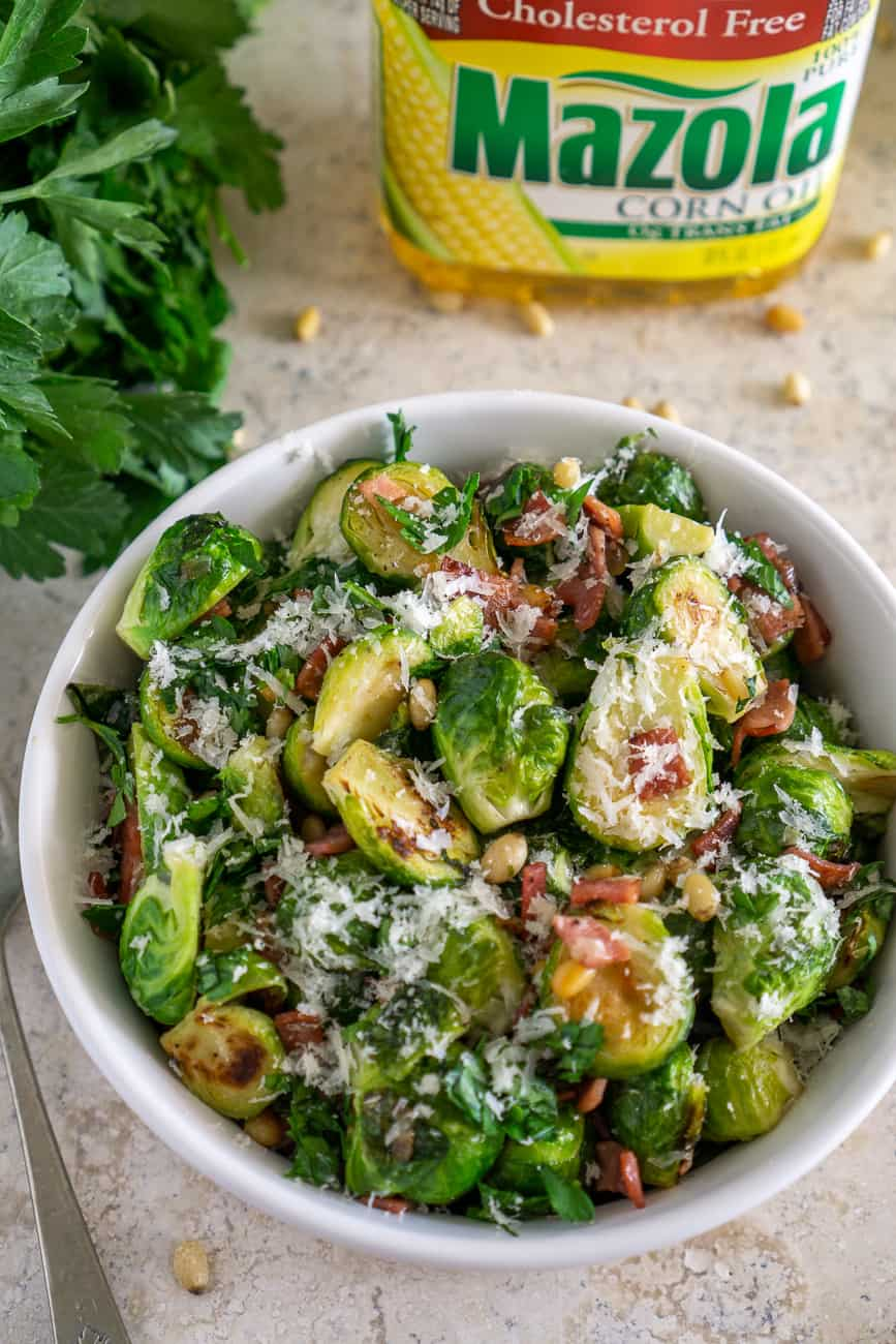 image of brussels sprouts side dish in front of mazola corn oil