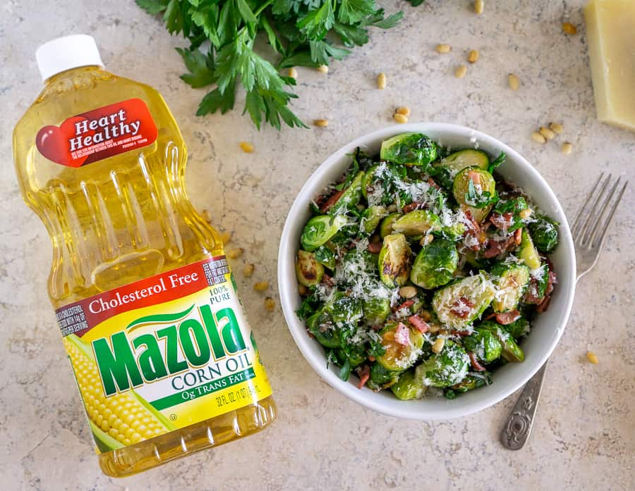 image of brussels sprouts side dish next to Mazola corn oil