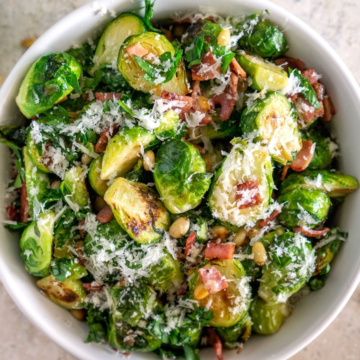 pan-fried brussels sprouts with parmesan and bacon in a bowl