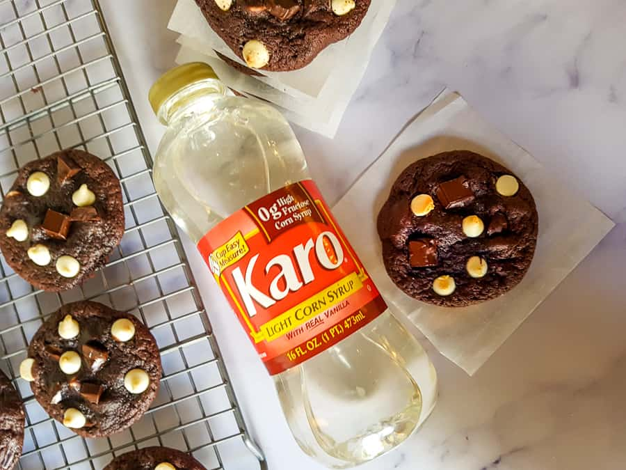 overhead shot of karo syrup bottle next to chocolate cookies