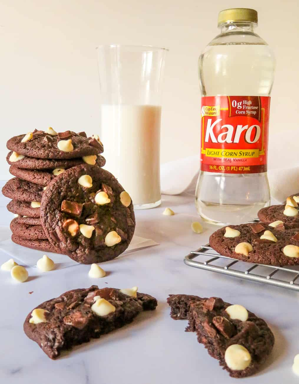 chewy chocolate cookies with a glass of milk and karo syrup