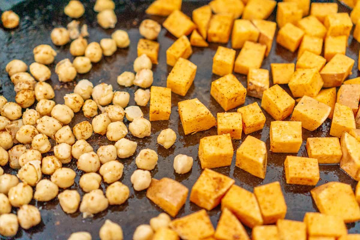 roasted cajun sweet potato and chickpeas on a sheet pan