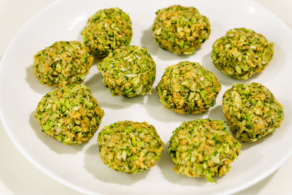 broccoli meatballs on a plate ready to be cooked