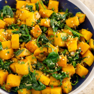 butternut squash and spinach on a plate