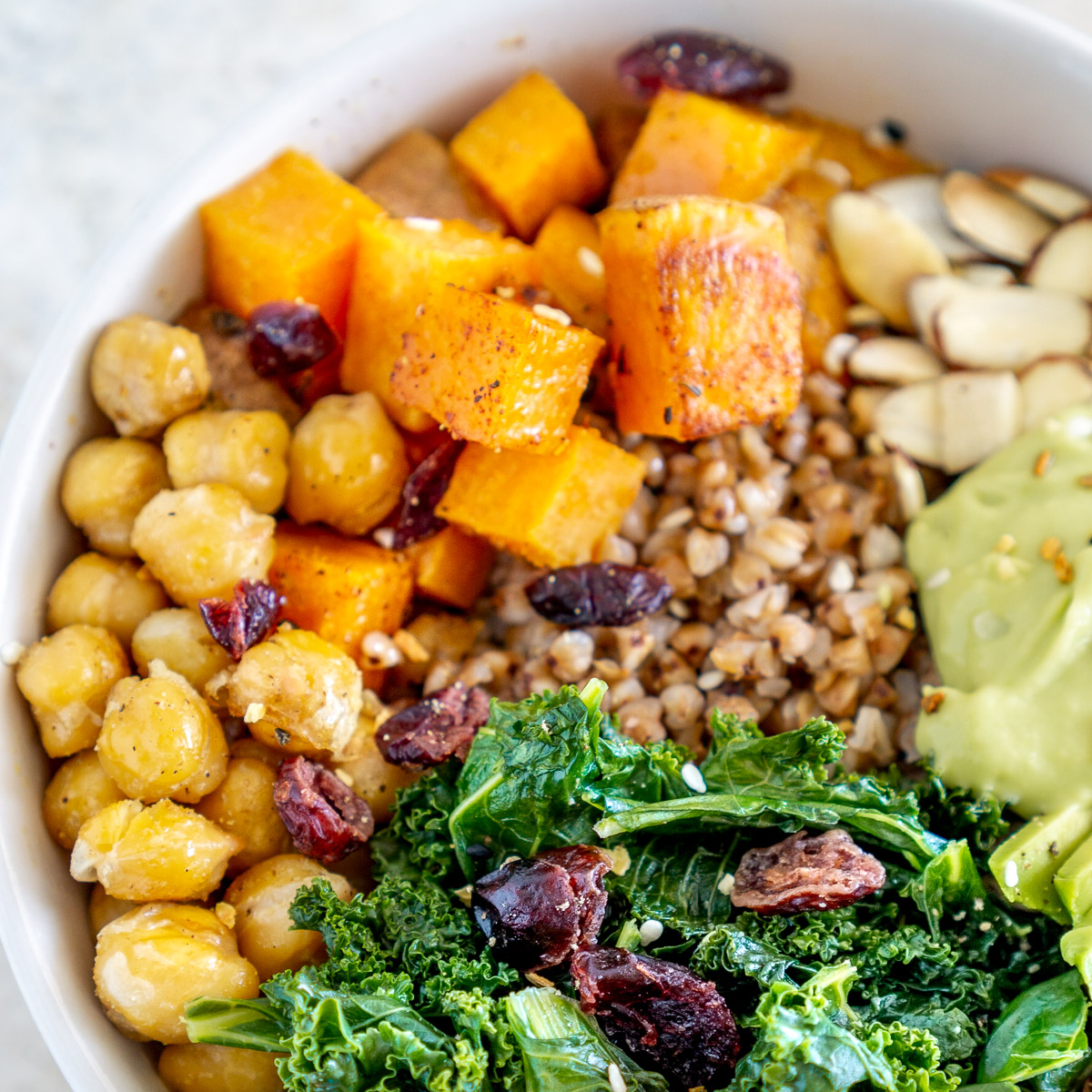 close up of buckwheat bowl with sweet potato, chickpeas and kale