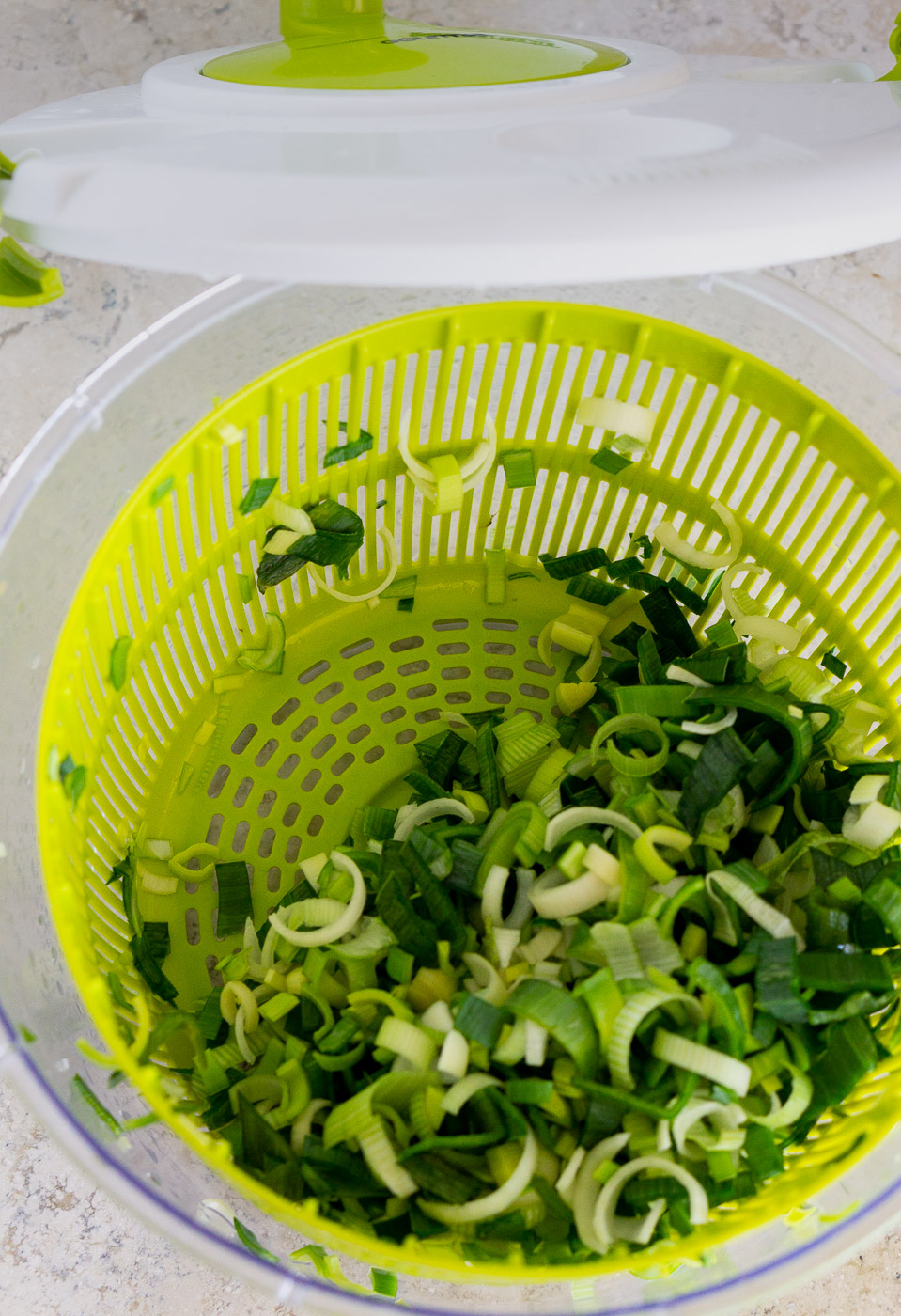 sliced leek in a salad spinner