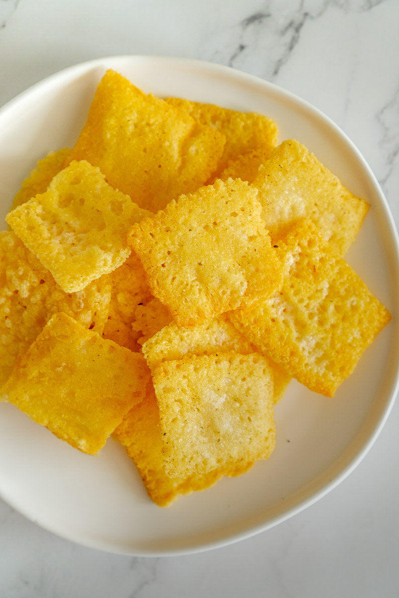 keto asiago cheese crackers on a plate