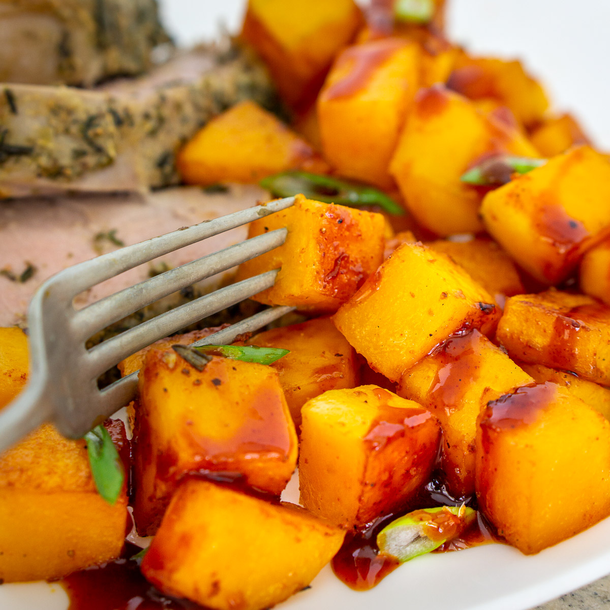 gochujang roasted butternut squash cubes on a plate