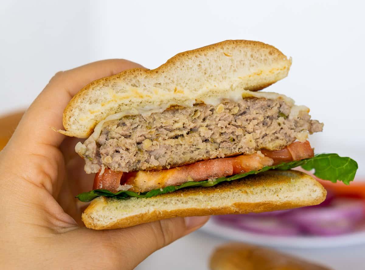 pork burger sliced in half