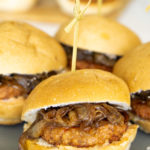 caramelized onion sausage sliders on a plate