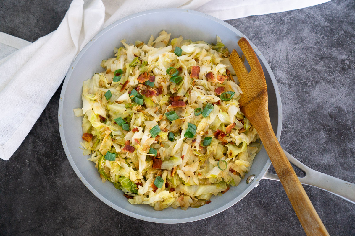 sauteed cabbage and bacon on a skillet
