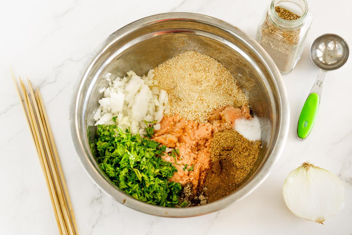 bowl of ingredients for chicken kofta kebabs