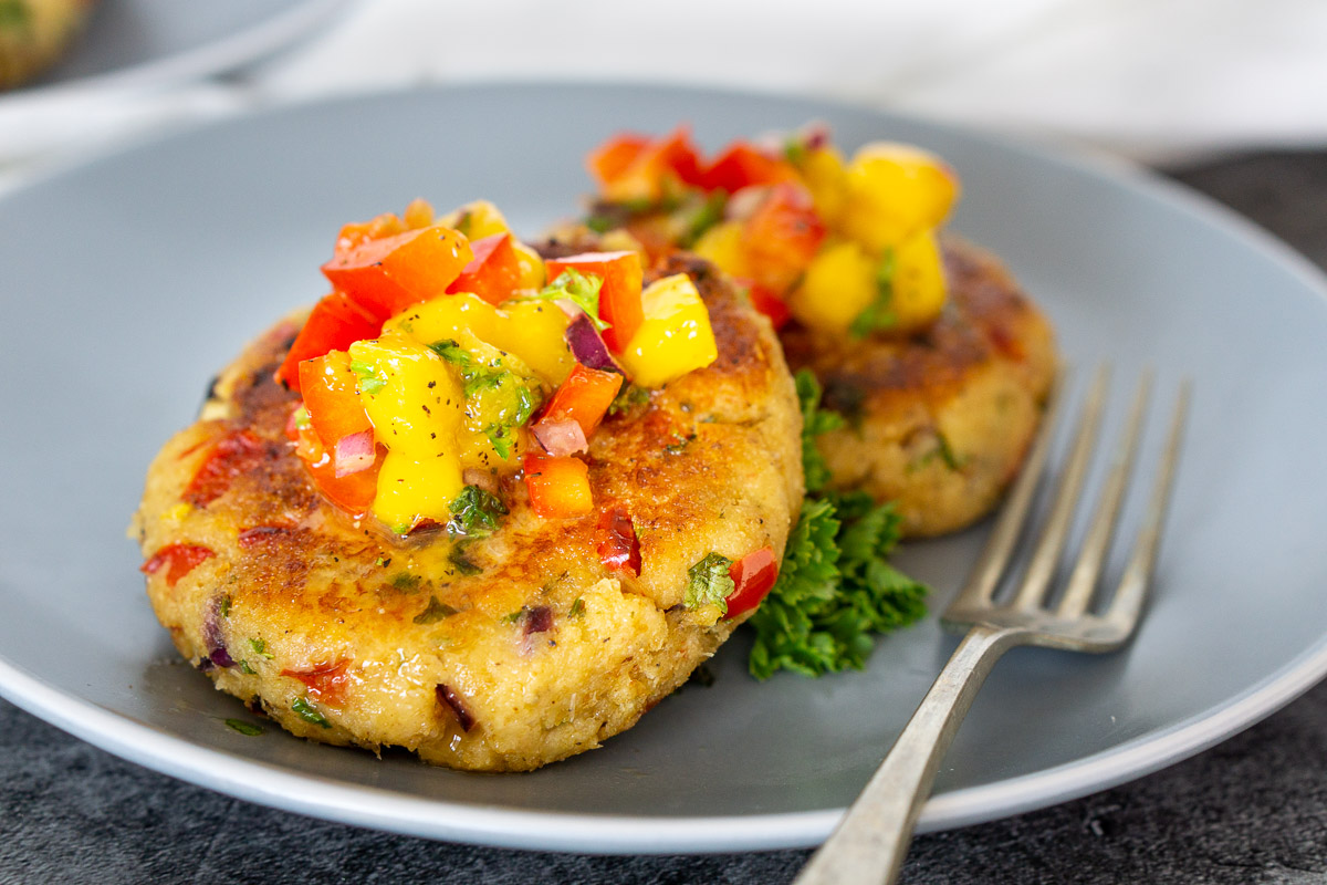 crab cakes with mango relish on a plate