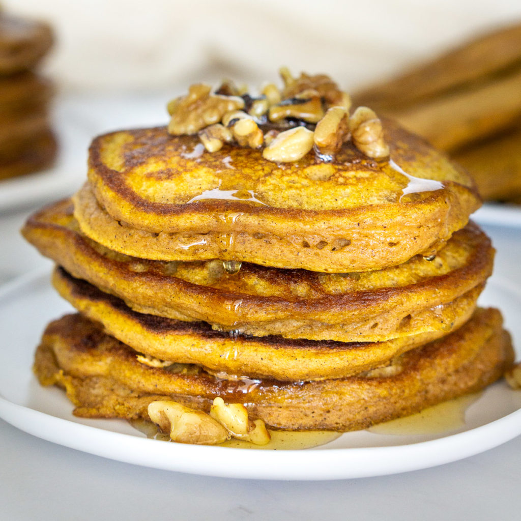 stack of pumpkin protein pancakes on a plate