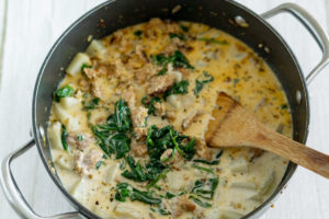 adding spinach to vegan zuppa toscana