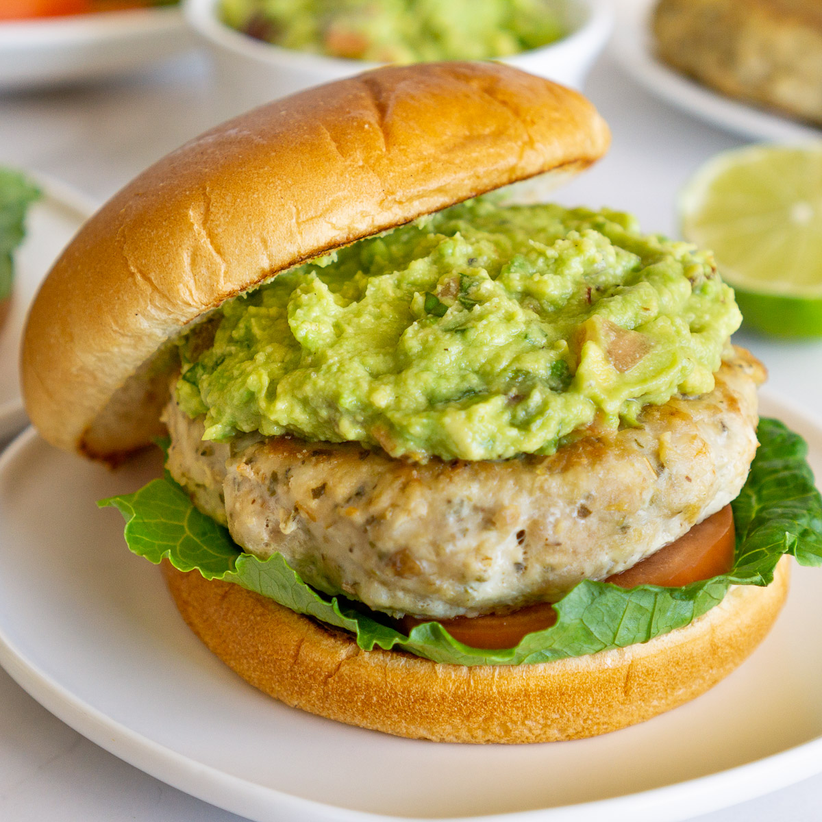 chicken burger with guacamole on a plate