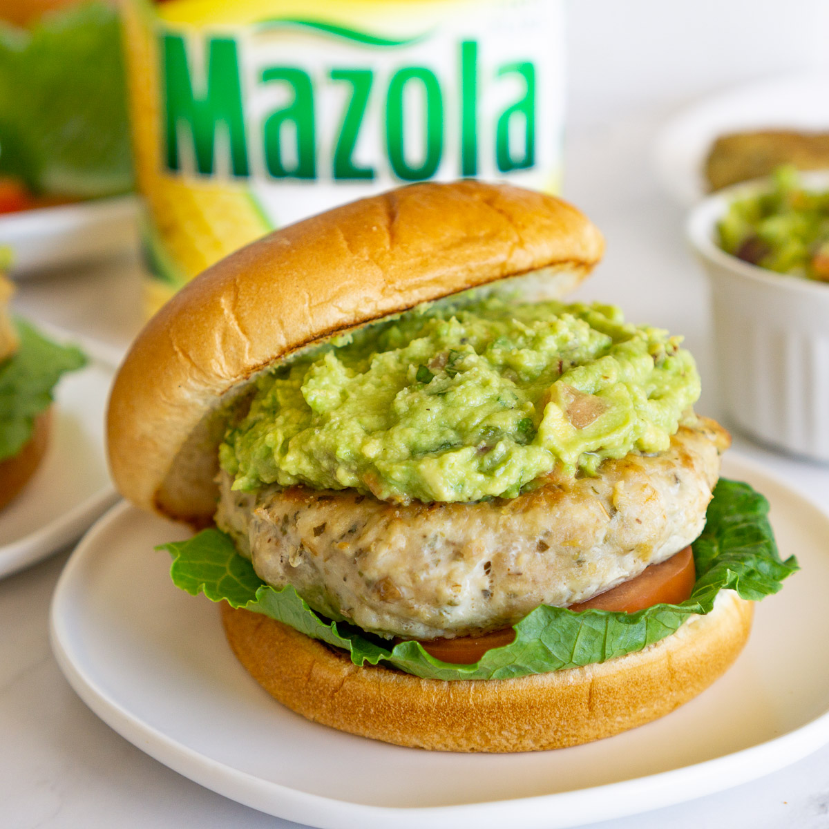 ground chicken burger topped with guacamole