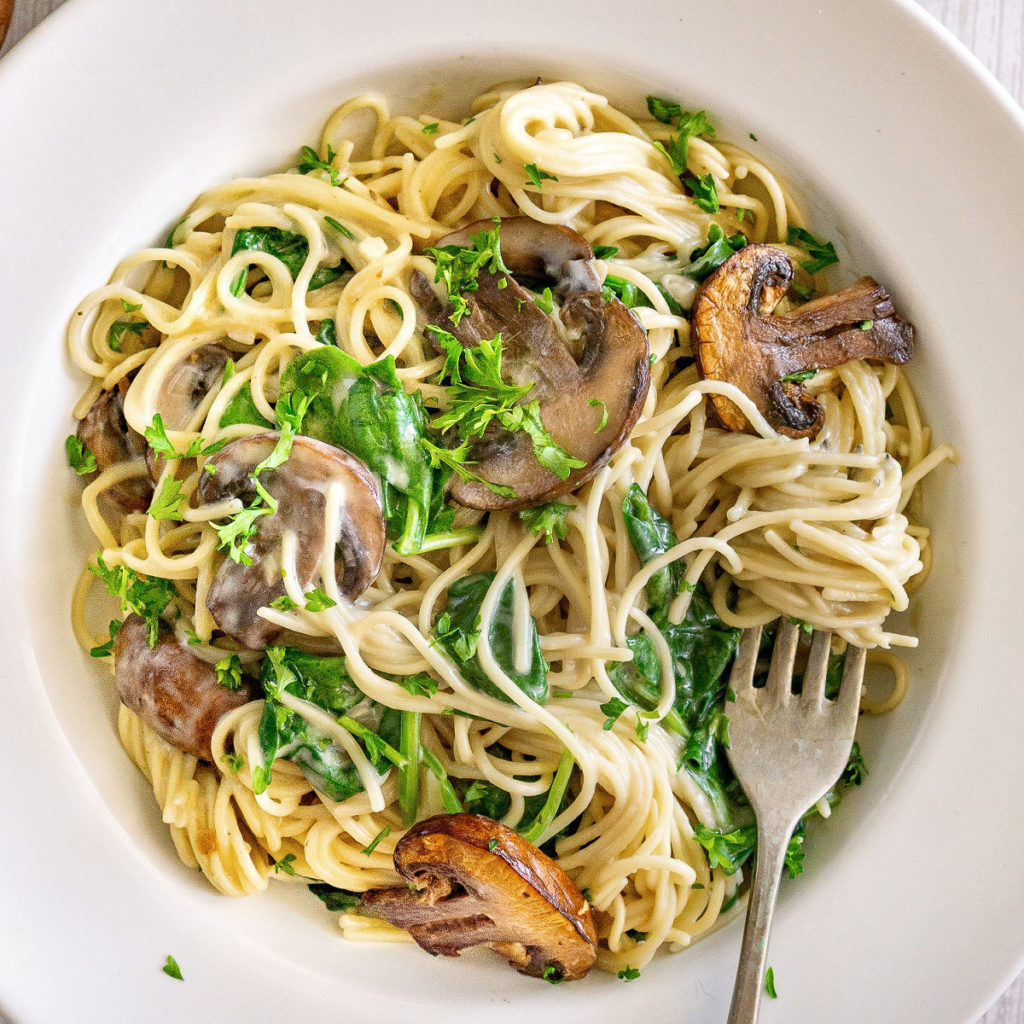 creamy mushroom pasta with spinach on a plate