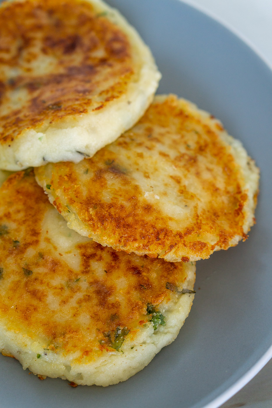 crispy mashed potato cakes on a plate
