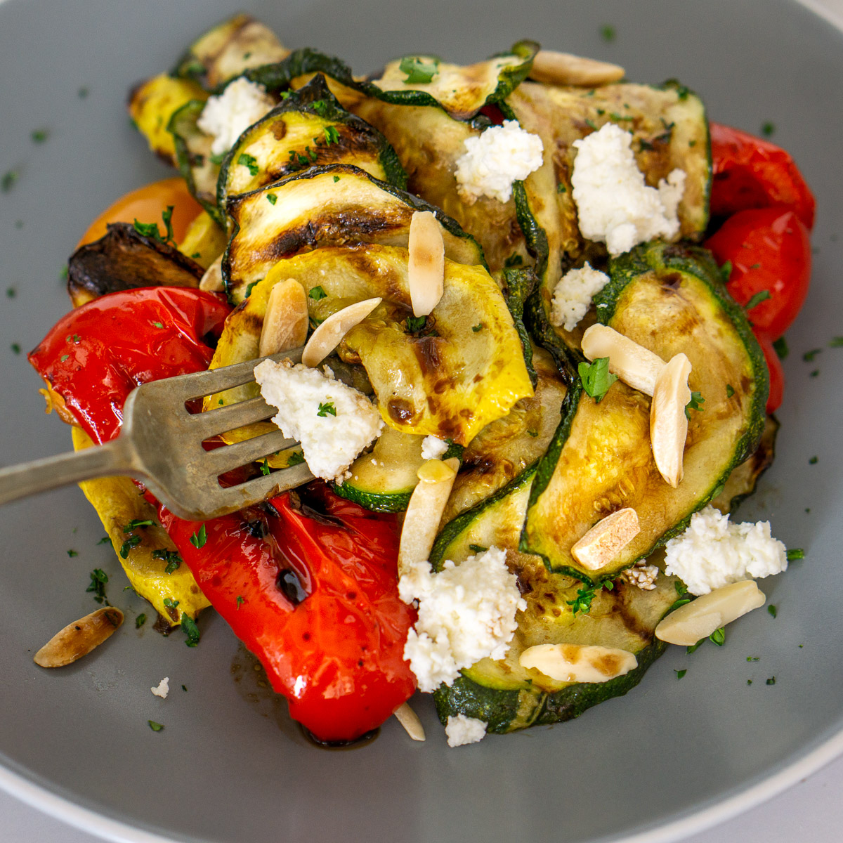 grilled zucchini salad on a plate with balsamic glaze